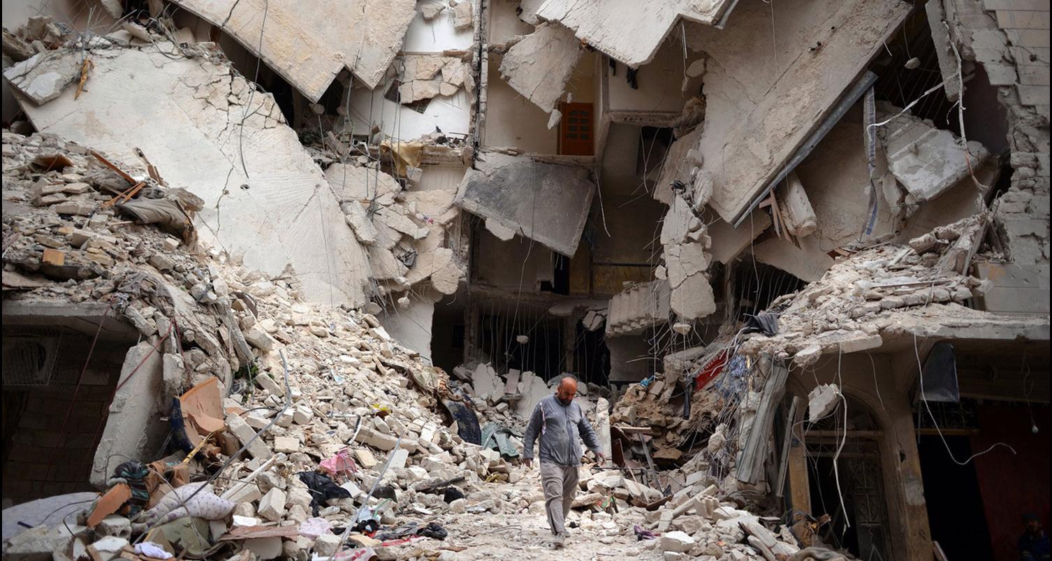 Один из разрушенных районов в Сирии