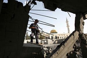 Ольмерт заявил о продолжении операции против палестинцев