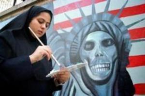 Пропагандистский ответ Ирана США: девушка-мусульманка рисует антиамериканский плакат
