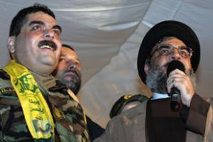 Хассан Насрулла (справа) назвал обмен заключенными победой Ливана
