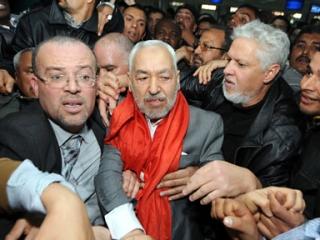 Тысячи людей встретили Ганнуши в аэропорту Туниса