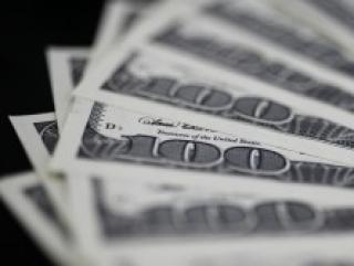 США паразитируют на монополии доллара — Путин