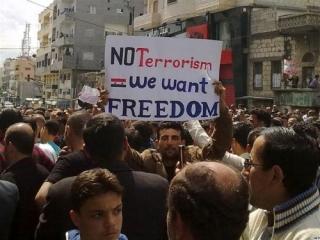 Сирийцы считают указ о многопартийности уловкой