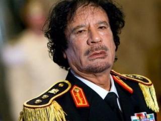 Каддафи тайно похоронен в пустыне