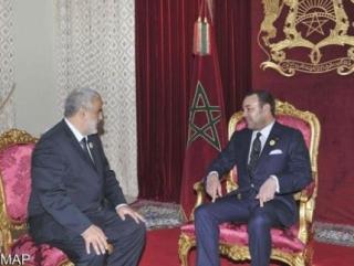 Абделилах Бенкиран (слева) и король Марокко Мухаммед VI. 29 ноября 2011 года