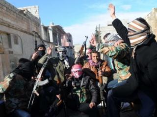 Сирийские мятежники в провинции Идлиб, где на днях были убиты судья и гособвинитель