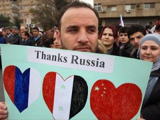 Участник проправительственной демонтрации в Дамаске
