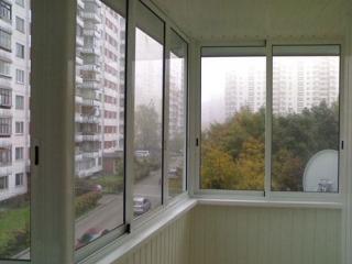 Раздвижные пластиковые окна в балконном остеклении