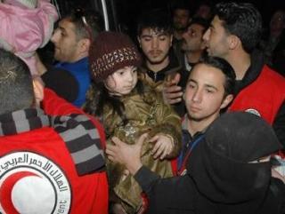 Сотрудники Красного полумесяца доставили гуманитарную помощь в Хомс