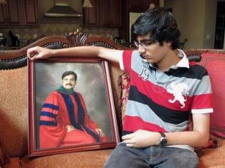 Сын убитого с портретом д-ра Камара