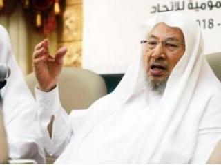 Шейх Юсуф аль-Кардави на миротворческой конференции в Дохе