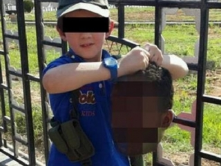 Сынок боевика ИГИЛ с отрезанной головой