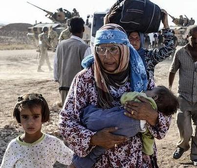 60 000 сирийских курдов за сутки бежали в Турцию из Ирака