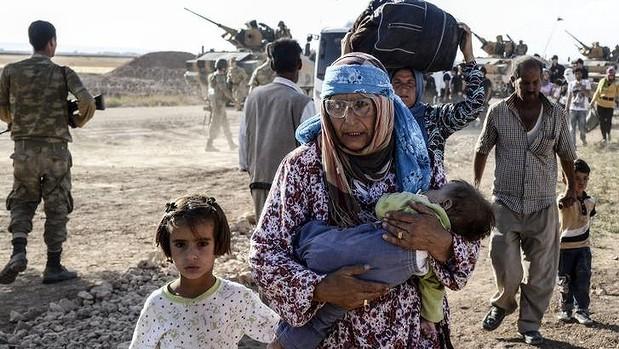 Сирийские курды, перешедшие сегодня границу с Турцией