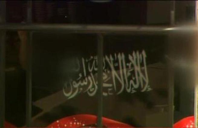 Эксперт: Заложники террориста в Сиднее держат флаг, похожий на саудовский