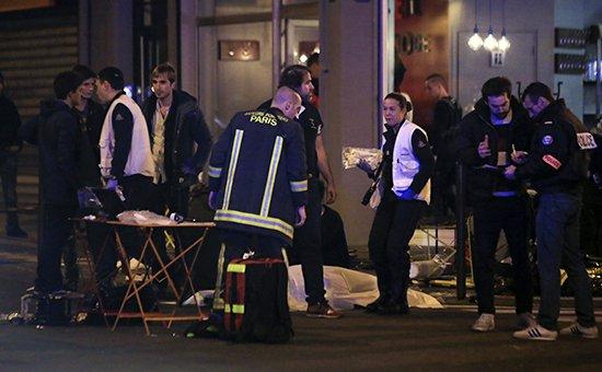 Полиция Парижа на месте,  где произошла стрельба Фото: AP
