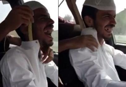 Саудиец смеется над смертью с коброй на шее (ВИДЕО)