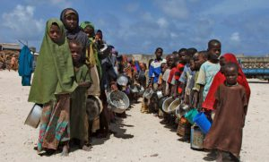 children-from-southern-somalia-hold-their-pots-as-they-line-up-to-receive-food-aid-during-the