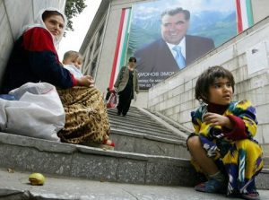 A mother and her children beg in a pedestrian underpass as a picture of Tajik President Emomali Rakhmonov is featured on a building in Dushanbe, 23 October 2006. The post-Soviet nation now owes a total of 830 million US dollars to foreign creditors, including 510 million US dollars to international finance organizations such as the World Bank (307 million US dollars), the Asian Development Bank (100 million US dollars) and the Islamic Development Bank (41 million US dollars). AFP PHOTO / VYACHESLAV OSELEDKO