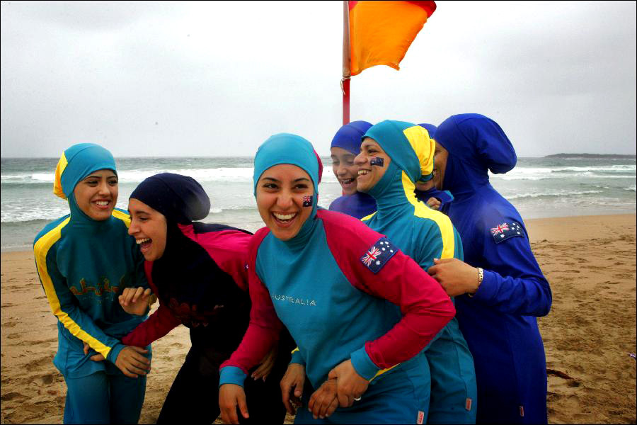 An undated handout photo, made available Thursday, Jan. 11, 2007, of young Muslim girls on a beach wearing a Burqini, produced by hairdresser-turned-designer Aheda Zanetti from Sydney, which allows the women to enjoy water sports without compromising their religious beliefs. (AAP Image/Supplied) NO ARCHIVING, EDITORIAL USE ONLY