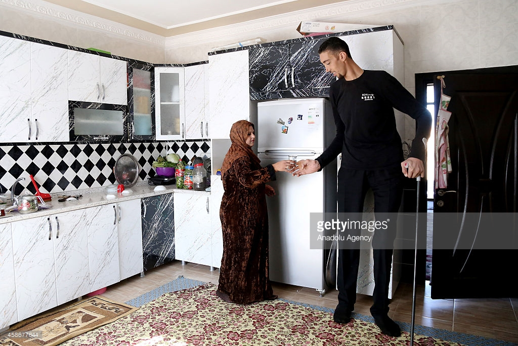 MARDIN, TURKEY - NOVEMBER 09: Sultan Kosen, world's tallest living male at 2.51 meters, and his wife, Merve Dibo, are seen at home on their wedding anniversary in Mardin, Turkey, on November 9, 2014. Sultan Kosen is a Turkish farmer who holds the Guinness World Record for tallest living male at 2.51 m (8 ft 3 in). (Photo by Ahmet Bolat/Anadolu Agency/Getty Images)