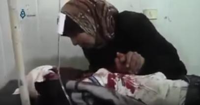 Сирия: мать произносит слова шахады умирающему от ран сыну (ВИДЕО 18+)