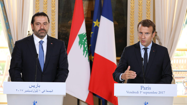 French President Emmanuel Macron (R) and Lebanese Prime Minister Saad Hariri give a press conference at the Murat Lounge in the Elysee Palace in Paris on September 1, 2017. / AFP PHOTO / POOL / ludovic MARIN