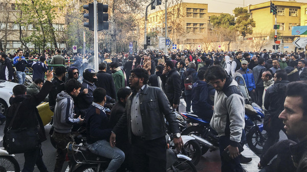 In this photo taken by an individual not employed by the Associated Press and obtained by the AP outside Iran, demonstrators gather to protest against Iran's weak economy, in Tehran, Iran, Saturday, Dec. 30, 2017. A wave of spontaneous protests over Iran's weak economy swept into Tehran on Saturday, with college students and others chanting against the government just hours after hard-liners held their own rally in support of the Islamic Republic's clerical establishment. (AP Photo)