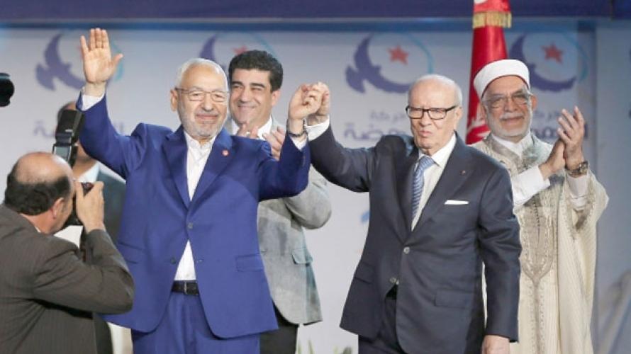 Лидер исламского политического  движения Туниса Рашид Ганнуши с президентом страны секуляристом Баджи ас-Сибси