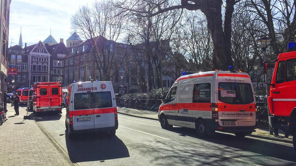Ambulances  stand in downtown Muenster, Germany, Saturday, April 7, 2018. German news agency dpa says several people killed after car crashes into crowd in city of Muenster.  (dpa via AP)