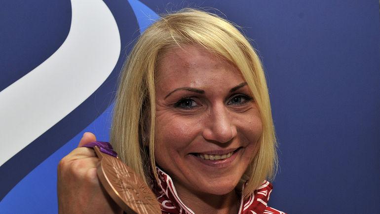 Ольга Забелинская с олимпийской медалью