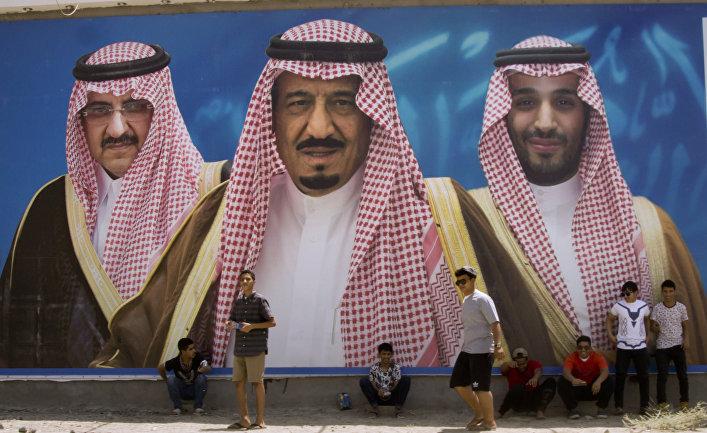 Изображение короля Саудовской Аравии, наследного принца и его заместителя в городе Таиф