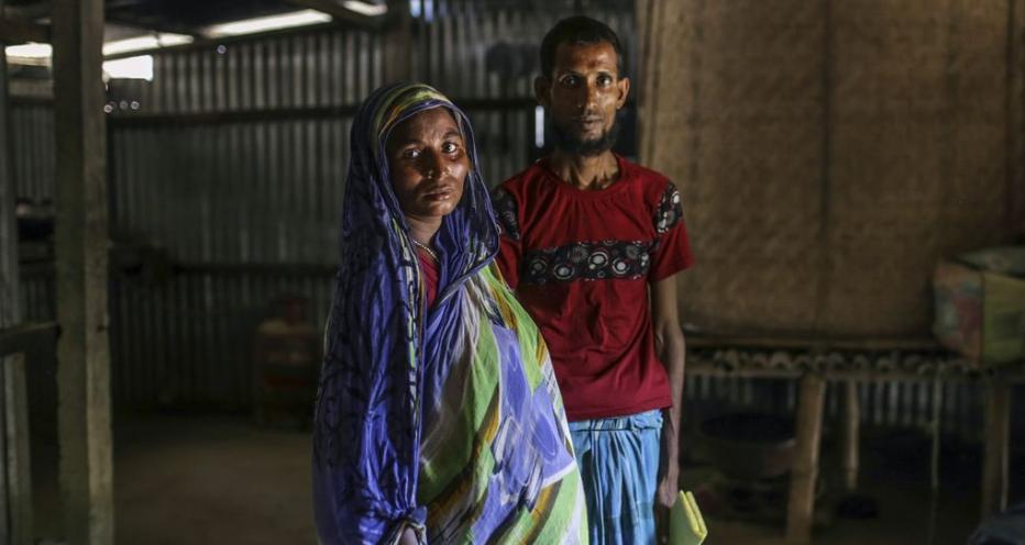 Мурисфул Бегум и ее муж (фото Bloomberg)
