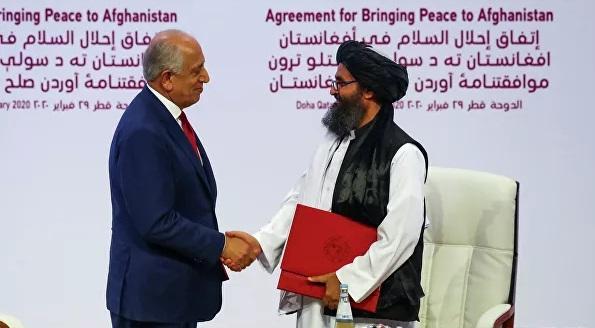 Церемония подписания соглашения в Дохе. Фото: Reuters